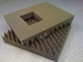Convoluted and die cut polyurethane packaging foam